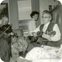 Grandma playing guitar.